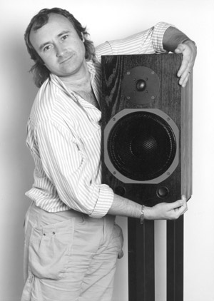 Phil Collins hugging a Wellard Research studio monitoring loudspeaker from Myst Ltd